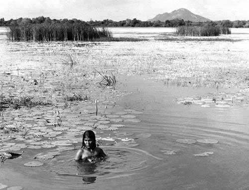 Girl bathing in wewa. Photo by Steven Champion