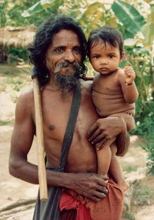 Dambana Kiri Banda and grandchild. Click to visit Vedda.org